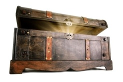 23073166 - vintage treasure chest opens to reveal a luminous but hidden secret