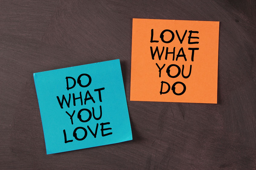 37143449 - 'love what you do and do what you love' notes pasted on blackboard.