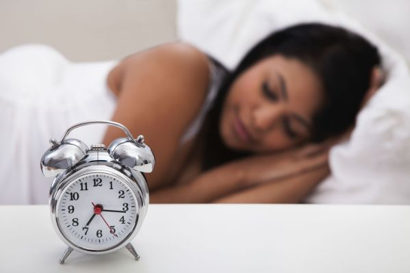 sleep-clock-sleeping-woman